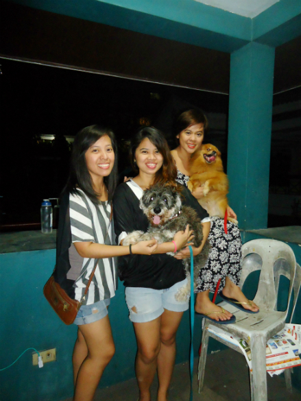with my sisters and our two dogs